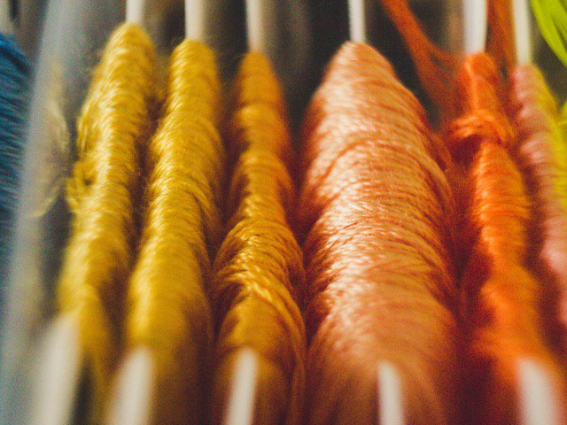 orange and yellow embroidery thread